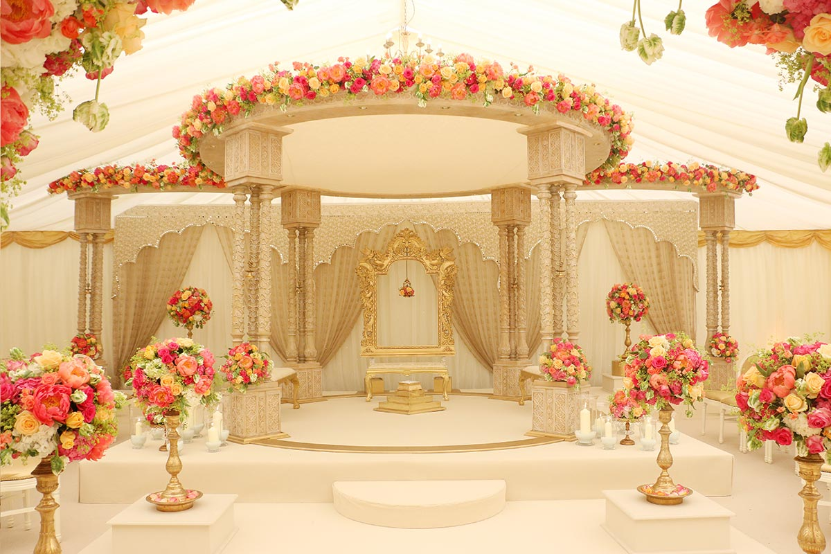 Shreya Carved 6 pillar Mandap with Summer Flowers and Floral Aisleway