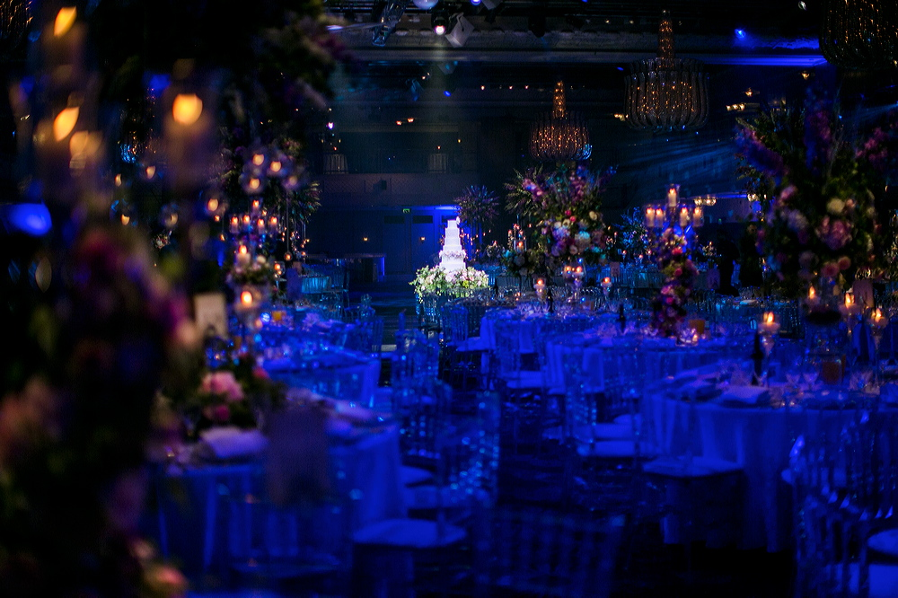 Wedding Reception at the Grosvenor House Great Room. Spriral of flowers around the candelabra