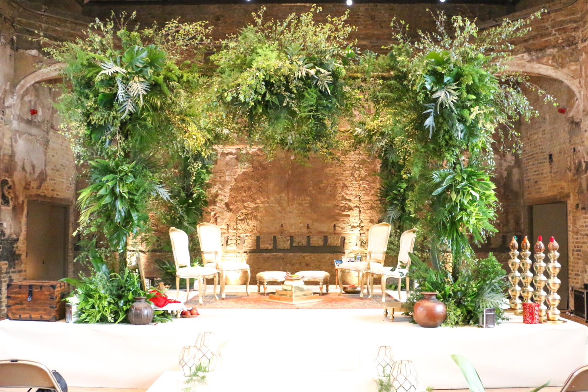 A four pillar square Mandap decorated with foliage, Tropical Mandap