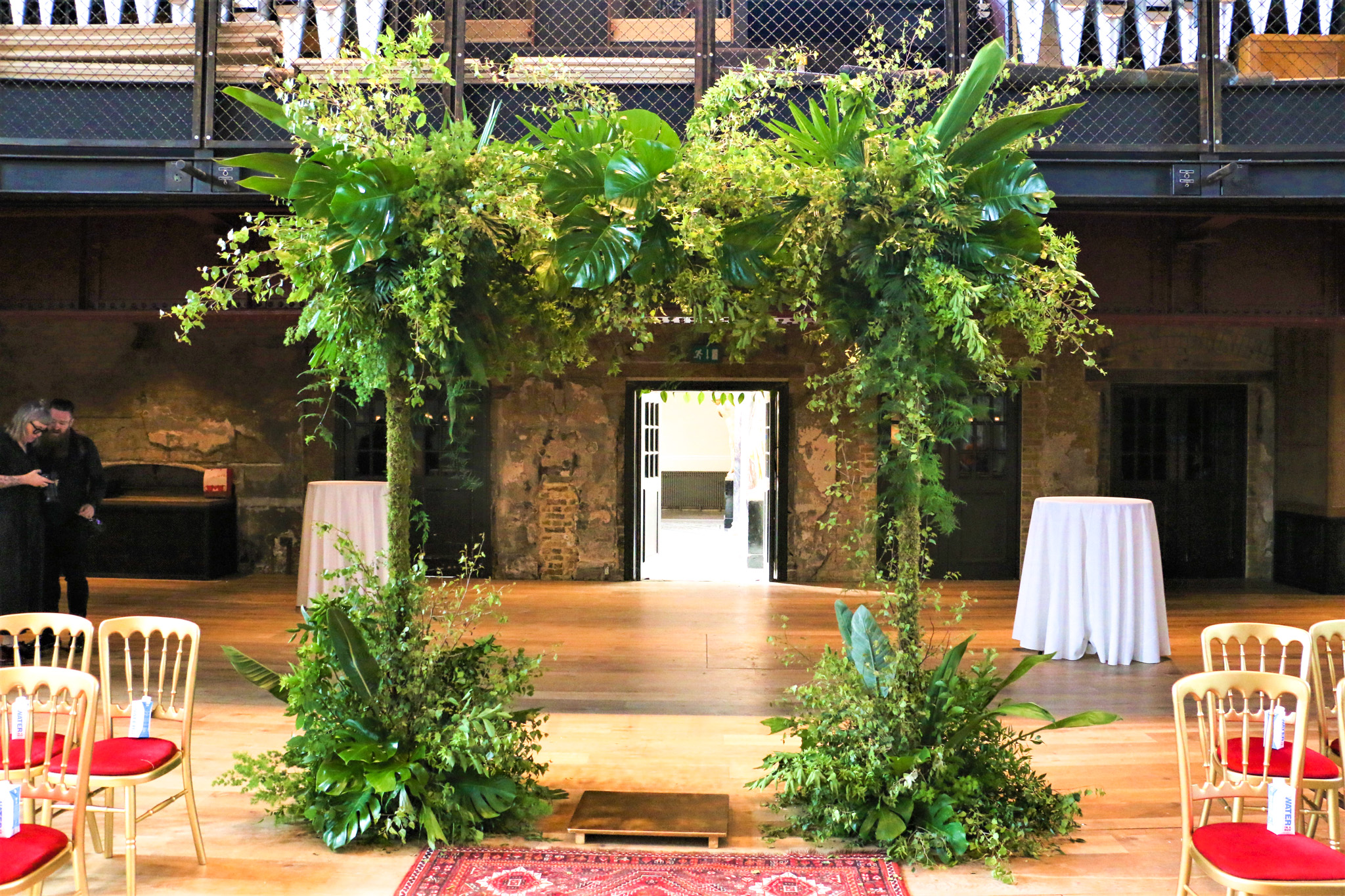 A tropical entrance arch to a Mandap wedding