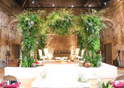 A four pillar square Mandap decorated with foliage, Tropical Mandap