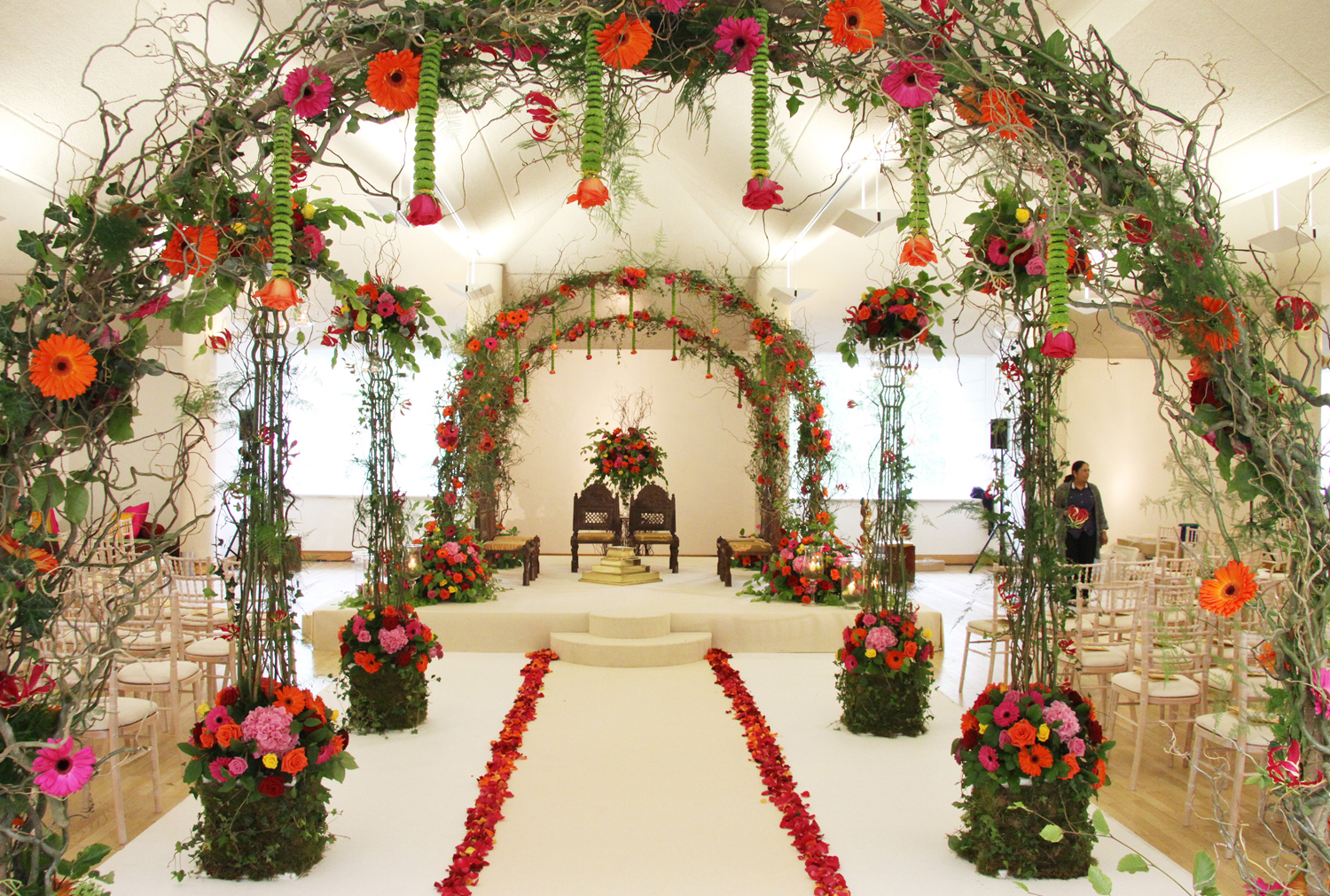 Enchanted Woodlanda Mandap with Floral aisle in tropical colours
