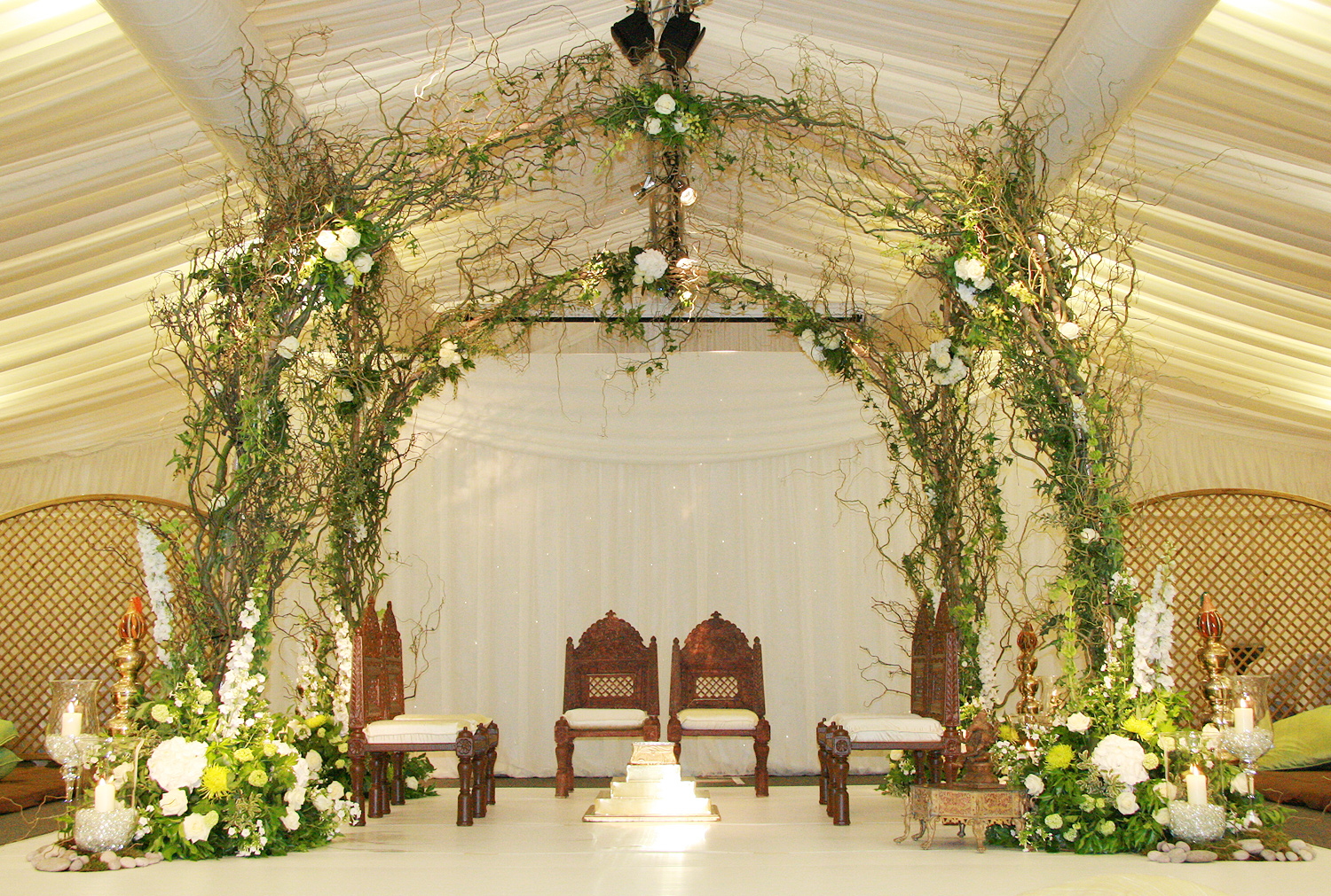Stunning Enchanted Woodland Mandap created from four arches bound together woven with willow branches